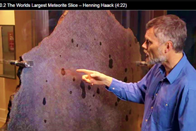 Henning Haack, Associate Professor, geophysicist, curator of the museum's meteorite collection, head of teaching at the Museum, and general instructor-in-charge, examines the World's Largest Meteorite Slice (I don't know why that tickles me so much).